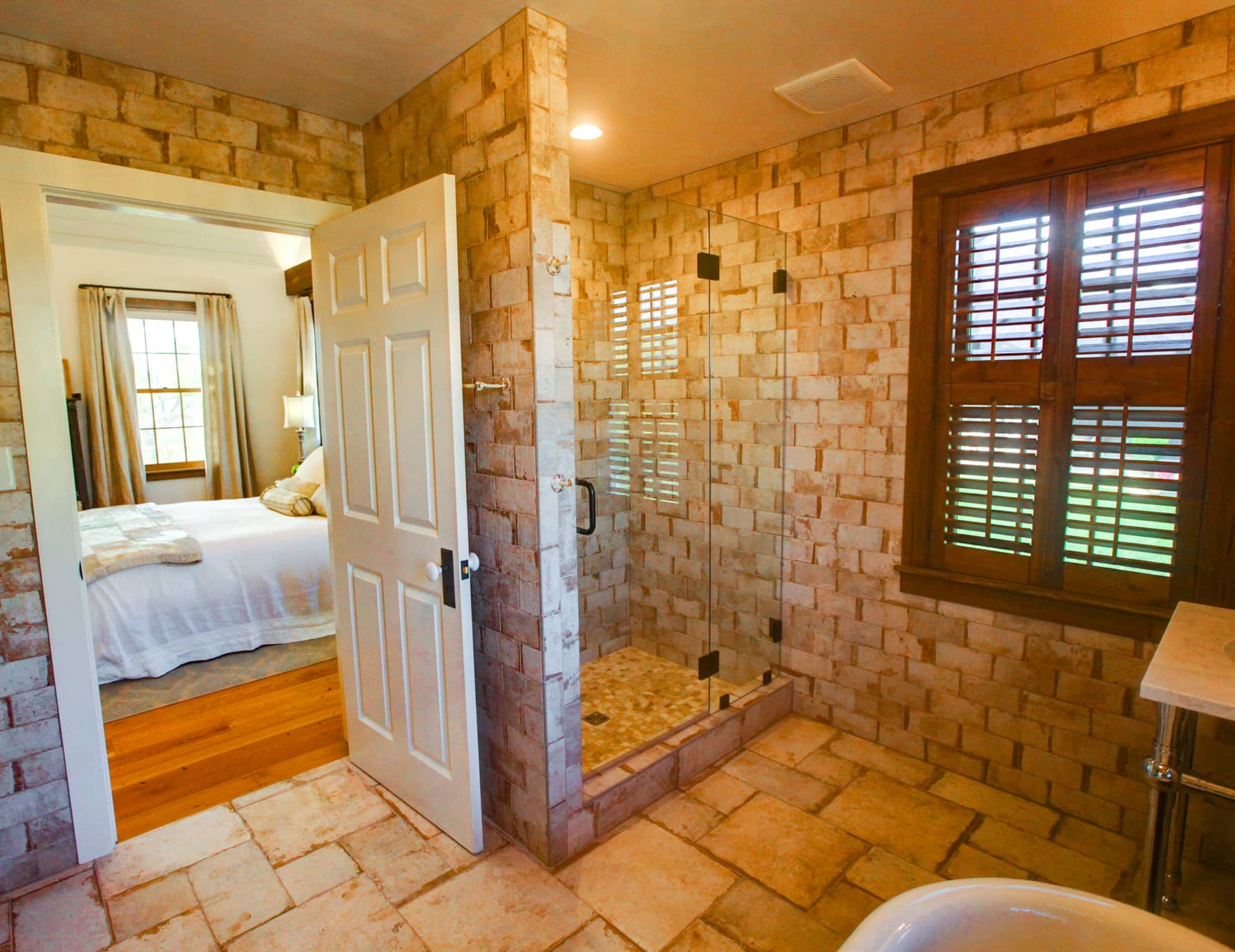 Bathroom with tile floors and a walk-in shower at a Virginia B&B