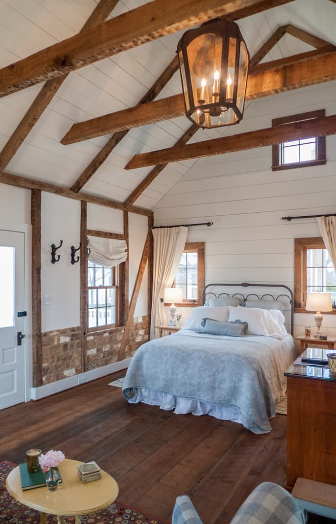Cottage room with a queen bed and half-kitchen, and high ceilings